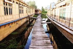 Houseboats in Srinagar. Typical houses in a boats on the Dal lake, heritage of British time in Kashmir stock image