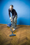 Houseboy. Doing housework and using the vacuum cleaner Stock Images
