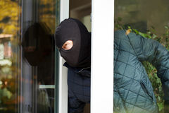 Housebreaker wearing a mask Royalty Free Stock Photos
