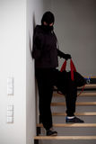 Burglar on stairways Royalty Free Stock Image