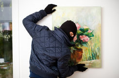 Stealing the work of art. Stock Photo
