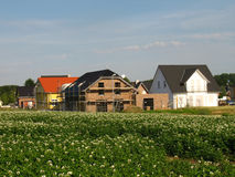 Housebuilding in a new district. Beside a potato field Royalty Free Stock Photo