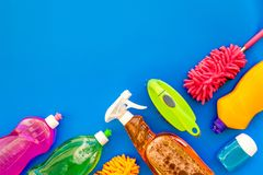 Housecleaning with detergents, soap, cleaners and brush in plastic bottles on blue background top view mockup. Housecleaning with detergents, soap, cleaners and royalty free stock image