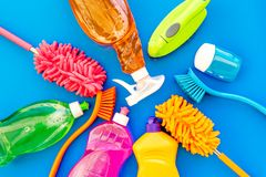 Housecleaning with detergents, soap, cleaners and brush in plastic bottles on blue background top view mockup. Housecleaning with detergents, soap, cleaners and royalty free stock images