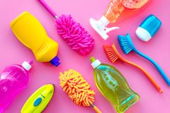 Housecleaning with detergents, soap, cleaners and brush in plastic bottles on pink background top view mockup. Housecleaning with detergents, soap, cleaners and stock photos