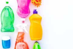 Housecleaning with detergents, soap, cleaners and brush in plastic bottles on white background top view mockup. Housecleaning with detergents, soap, cleaners and royalty free stock photography