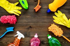 Housecleaning with detergents, soap, cleaners and brush in plastic bottles on wooden background top view mockup. Housecleaning with detergents, soap, cleaners royalty free stock photography