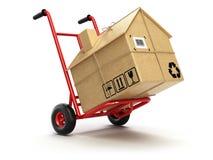 交付或移动的houseconcept 有纸板箱的a手推车 免版税库存照片