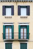 Housefront with Window Shutters Stock Photo