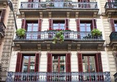 Housefront with windows and balcony.Barcelona. Stock Photography