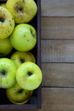 Household apples in wooden crate, top view Royalty Free Stock Photography