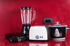 Household appliances in modern kitchen red background Stock Photo