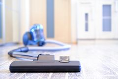 Household appliances, vacuum cleaner. The concept of cleanliness and order in the premises.  stock photo