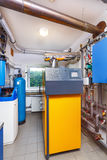 A household boiler room with a boiler on firewood, a barrel; Val Royalty Free Stock Photos