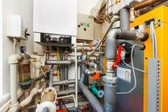 Household boiler room with gas boiler, barrel; Valves; Sensors a Stock Photos