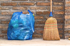 Household Broom For Floor Cleaning and Garbage Bag Royalty Free Stock Image