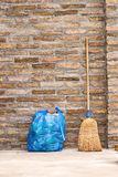 Household Broom For Floor Cleaning and Garbage Bag Royalty Free Stock Photo