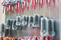Household brushes for dishes in store. Household brushes for dishes in the store of household goods Stock Photo