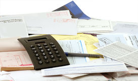 Household Budget. Calculator, legal pad and receipt book and lots of BILLS Royalty Free Stock Image