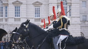 Household Cavalry at Horse Guards Parade. LONDON, UK - APRIL 20: Members of the Household Cavalry on duty at Horse Guards building during the ceremony of stock footage
