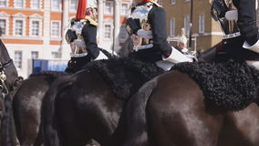 Household Cavalry at Horse Guards Parade. LONDON, UK - APRIL 20: Members of the Household Cavalry on duty at Horse Guards building during the ceremony of stock video footage