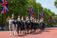 Household Cavalry walk along The Mall in London, England. Towards Buckingham Palace.  The parade of the Horse Guards is very popular with visitors Royalty Free Stock Photography