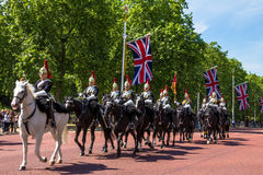 Household Cavalry walk along The Mall in London, England. Towards Buckingham Palace.  The parade of the Horse Guards is very popular with visitors Royalty Free Stock Images