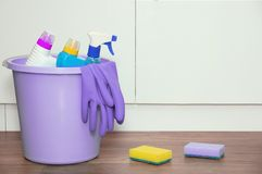Household chemicals for cleaning house in a bucket on the floor. royalty free stock image