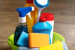 Household chemicals stacked in a green bucket royalty free stock photography