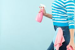 Household chore woman atomizer sponge copy space. Household chores. Organized housewife. Woman holding atomizer and sponge with cloth in pocket. Copy space on royalty free stock photo