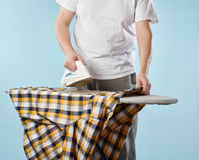 Household chores, ironing man Royalty Free Stock Photography