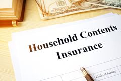 Household contents insurance policy. Household contents insurance policy on a desk Royalty Free Stock Photo