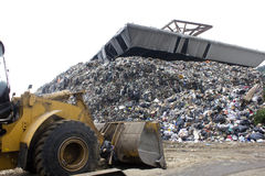 Household disposal is trucked to be compacted. A view of waste in a dump Royalty Free Stock Photos