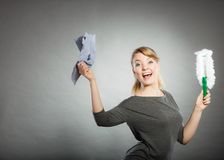 Girl with cleaning cloth in hand. Royalty Free Stock Image
