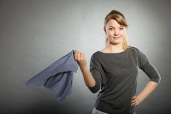 Girl with cleaning cloth in hand. Royalty Free Stock Photography