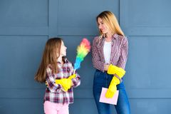 Household duties family housekeeping home cleaning. Household duties and family combined efforts. mom and daughter ready for housekeeping and home cleaning royalty free stock photos