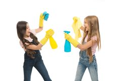 Household duties. Little helper. Girls cute kids cleaning around with mist sprayer. Keep it clean. Sisters rivalry. Who. Did better. Girls with yellow rubber stock photo