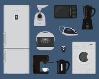 Household electrical appliances on a blue background. There is a fridge, washing machine, meat grinder, kettle, microwave, blender, coffee machine, iron and Stock Photography