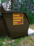 Household Garbage Only Dumpster in Campground Stock Photo