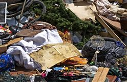 Household Garbage & Junk. Pile of household garbage on the curb awaiting trash pickup Royalty Free Stock Photography