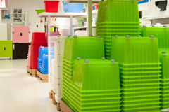 Household goods store, plastic containers. Plastic containers, furniture and other stuff in household goods section in a department store royalty free stock images
