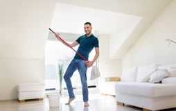 Man with mop and bucket cleaning floor at home Royalty Free Stock Image