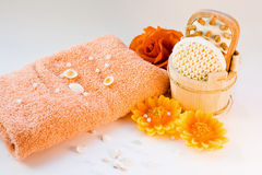 Household Items For Cleanliness. Beauty items with aromatherapy candles, towel, flowers stock photography