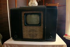 Household items 19th and 20th century. Museum of old things. Household items 19th and 20th century - lamp TV with cathode ray tube and micro-screen stock photo