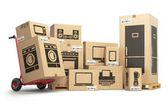 Household kitchen appliances and home electronics in carboard  Stock Image