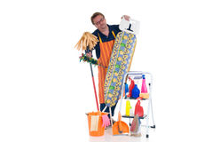 Household by man. Houseman with ironing-board and ladder with cleaning products for daily household Royalty Free Stock Photo