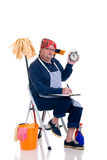 Household by man. Houseman sitting on ladder with cleaning products for daily household Royalty Free Stock Photo