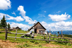 A household with an old wooden barn in the mountains Royalty Free Stock Images