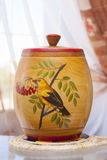 Household pot. Household wooden pot with drawing of bird Stock Images