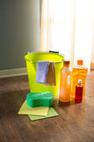 Household products. Wood cleaners and detergents on floor with bucket, gloves, cloth and sponges stock photo